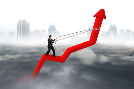 upward struggle: Businessman control arrow direction of red trend line with gray cloudy sky cityscape background Stock Photo
