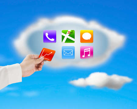 hand taking away app icon from cloud with nature blue sky background photo