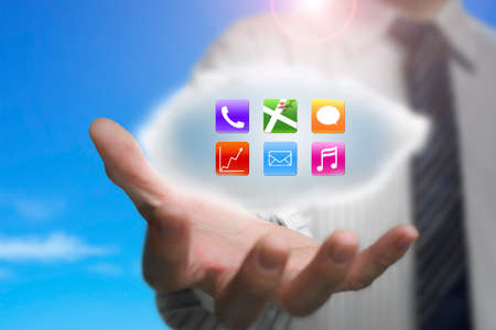 businessman showing colorful app icons on cloud with nature blue sky background photo