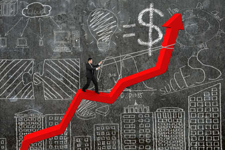 upward struggle: Businessman control arrow direction of red trend line with business concept doodles concrete wall background