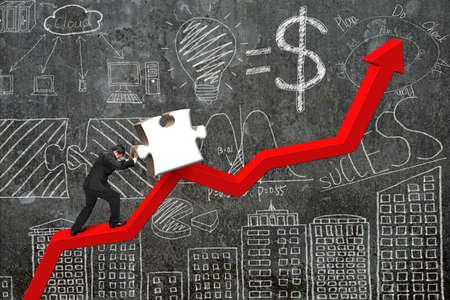upward struggle: businessman pushing 3D jigsaw puzzle upward on red trend line with business concept doodles concrete wall background