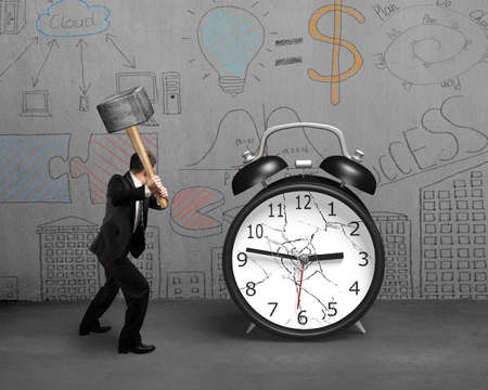 businessman hand using sledgehammer hitting alarm clock with broken glass on doodles concrete wall background