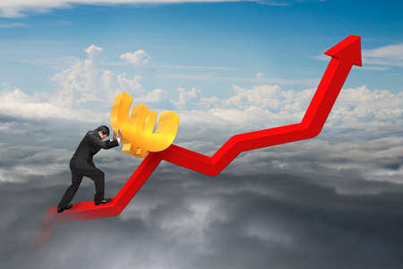 upward struggle: businessman pushing 3D euro sign at starting point of red trend chart with natural cloudscape background
