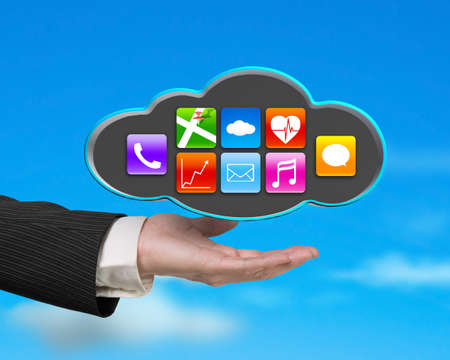 businessman showing black cloud with colorful app icons on nature blue sky background photo