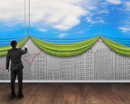 liberate: businessman pull open sky curtain covered cityscape doodles concrete wall on wooden floor background