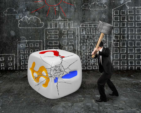 businessman holding sledgehammer hitting large dice with dollar sign and city buildings doodles wall background photo