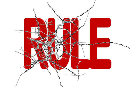 Red rule word with cracked transparent glass isolated on white background photo