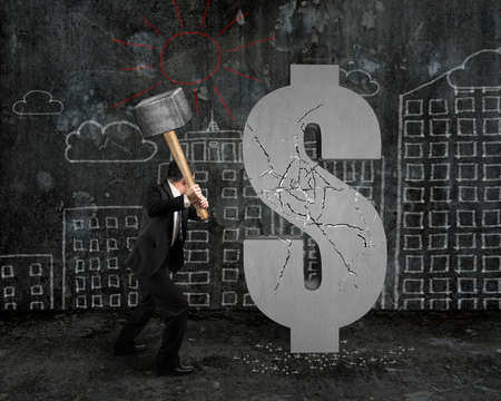 city  buildings: businessman holding hammer hitting cracked dollar sign with city buildings doodles background Stock Photo