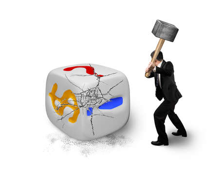 businessman holding sledgehammer hitting large dice with dollar sign isolated on white