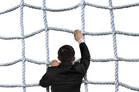 rope barrier: Businessman climbing the crisscross rope net isolated on white background