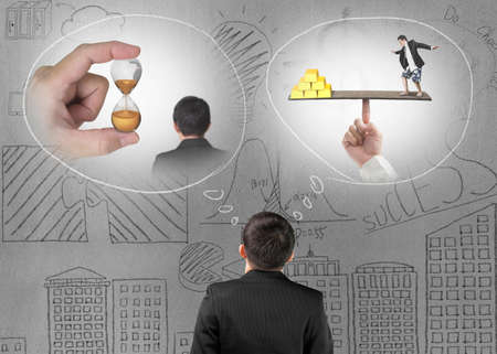 Businessman imagining work situation with doodles concrete wall background Stock Photo