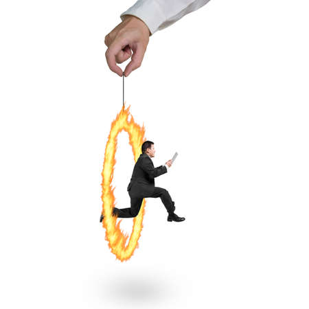 Businessman jumping through fire circle hand holding isolated on white background photo