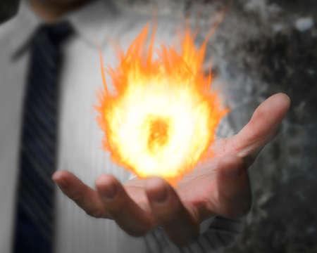 fire ball: Burning fire ball in businessmans hand