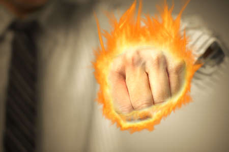 hands fire passion: Business man punching with fist of fire