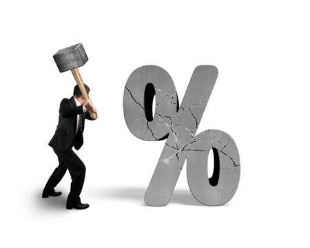 Businessman holding sledgehammer hitting cracked percentage sign isolated on white background Stock Photo