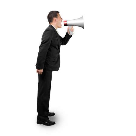 businessman using a megaphone: Businessman using megaphone yelling isolated on white background Stock Photo