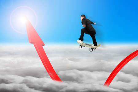 Businessman skateboarding on red arrow pointing up with sunlight cloudscape background photo