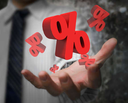 probability: Business man hand showing 3D red percentage signs Stock Photo