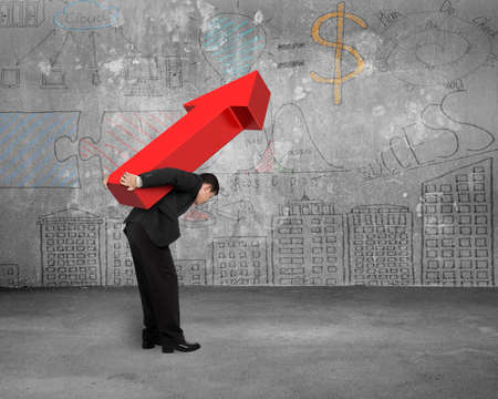 hard work ahead: Businessman carrying big 3D red arrow sign with business concept doodles wall Stock Photo