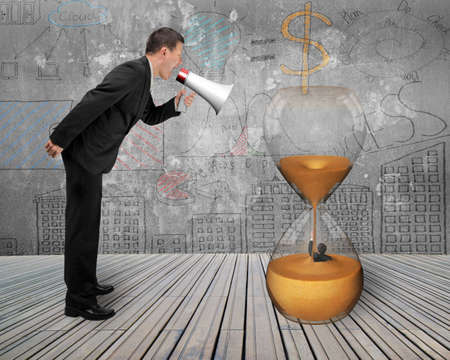 businessman using a megaphone: Businessman using megaphone yelling at man flooded in hourglass with doodles wall and wooden floor background