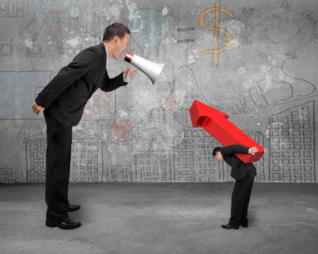 Boss using megaphone yelling at employee carrying big 3D red arrow sign with doodles wall and wooden floor background photo