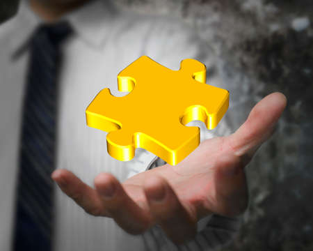 Glowing golden jigsaw puzzle in the businessman hand photo