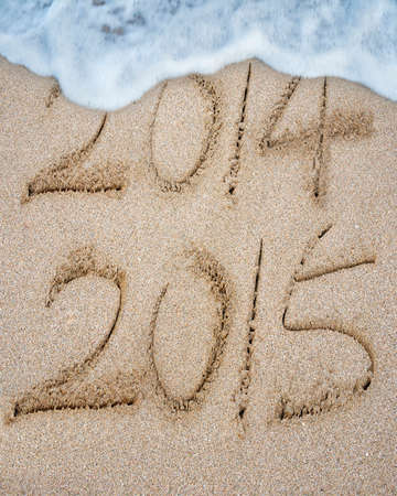 replace: New year 2015 replace 2014 on sand beach background
