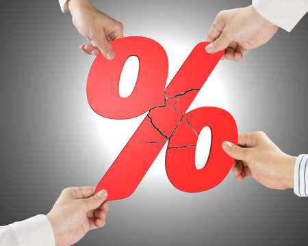 synergism: Group of business people assembling broken red percentage sign with gray background