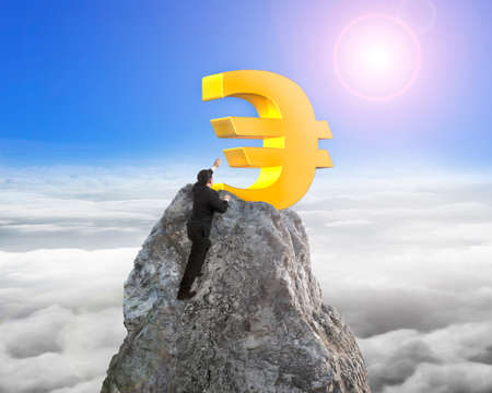 euro symbol: Businessman hand wanting for gold euro symbol on mountain peak with sunlight cloudscape background