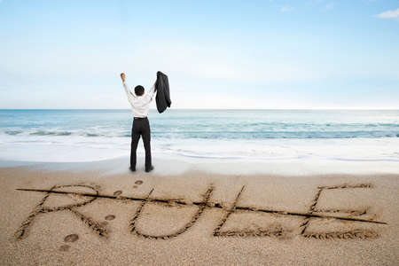 deleted: Businessman cheering with rule word deleted line written on sand beach background Stock Photo