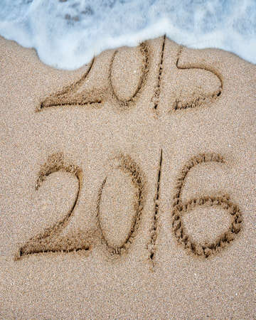 New year 2016 replace 2015 on sand beach background