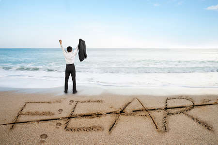 revise: Businessman cheering with fear word deleted line written on sand beach background