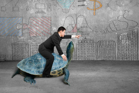 Businessman riding turtle and indicating with finger in the concrete room and business concept doodles wall background