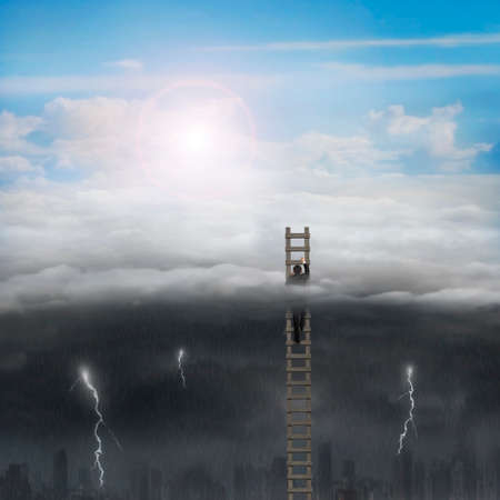 Businessman climbing on wooden ladder high in the sky with opposite weather conditions background, bright sun cloudscape, dark cloudy lightning raining