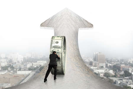wealth concept: Businessman pushing money circle on arrow up sign marble road with cityscape background Stock Photo