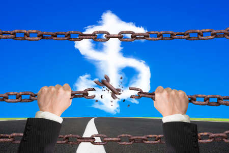 hands off: Rusty iron chains broken off by hands with dollar sign shape white clouds on sky asphalt road background
