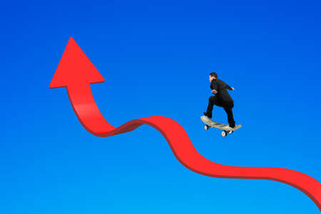 arrow up: Businessman skateboarding on red arrow up bending trend line with blue background