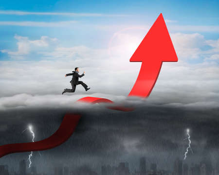 Businessman running on red arrow up bending trend line in the sky with opposite weather conditions background, sunny sky cloudscape, dark overcast lightning raining cityscape photo