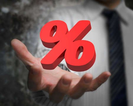 percentage sign: Business man hand showing 3D red percentage sign