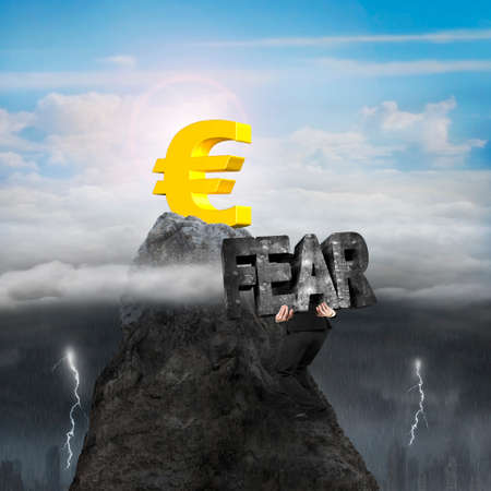 3d lightning: Man carrying 3d fear mottled concrete word, climbing toward golden euro symbol on mountain peak, with opposite weather conditions background, sunny sky cloudscape, dark overcast lightning raining cityscape Stock Photo