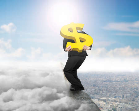 Businessman carrying big 3D gold dollar sign balancing on concrete ridge with sky cloudscape cityscape sunlight background photo