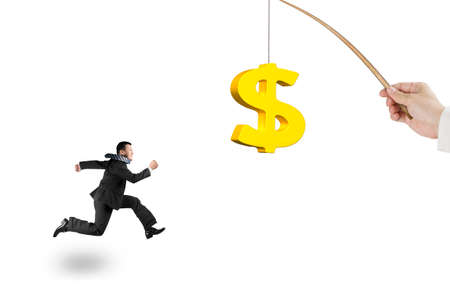 rod sign: Man running after 3D golden dollar sign bait on fishing rod hand holding, isolated on white background Stock Photo