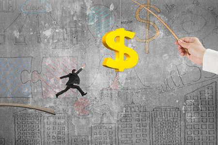 enticement: Man jumping for 3D golden dollar sign bait on fishing rod hand holding, with business concept doodles concrete wall background Stock Photo