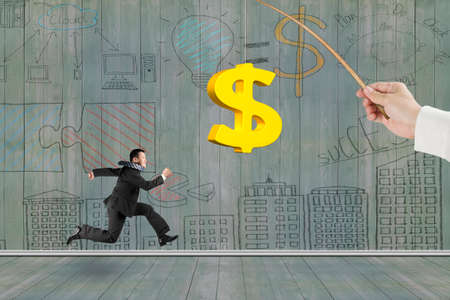 control fraud: Man running after 3D golden dollar sign bait on fishing rod hand holding, with business concept doodles wood wall background Stock Photo