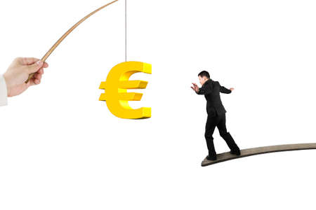 pursue: Man balancing on wood board for 3D golden euro symbol bait from fishing rod hand holding, isolated on white background Stock Photo