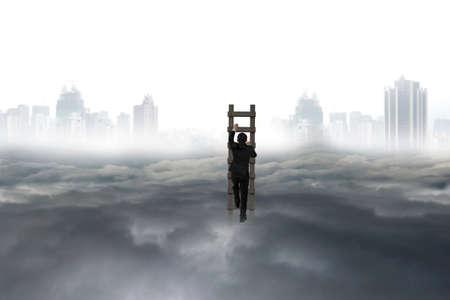 upward struggle: Business man climbing on wooden ladder with city landscape gray cloudscape background