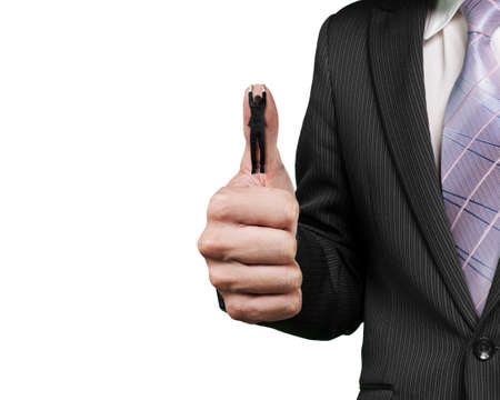 Businessman hanging on another big thumb against white background