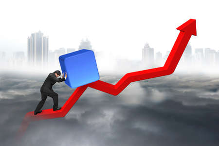 upward struggle: Business man pushing blue 3D block upward on red trend line with city landscape gray cloudscape background