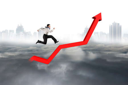 upward struggle: Business man running on red growth trend line with city landscape gray cloudscape background