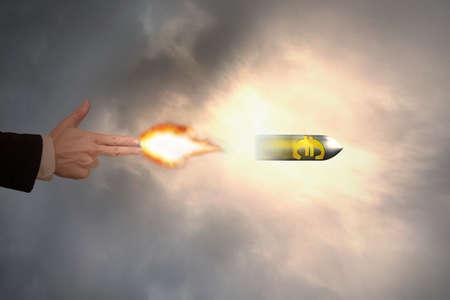 Hand of gun gesture with firelight shooting the euro sign bullet 版權商用圖片